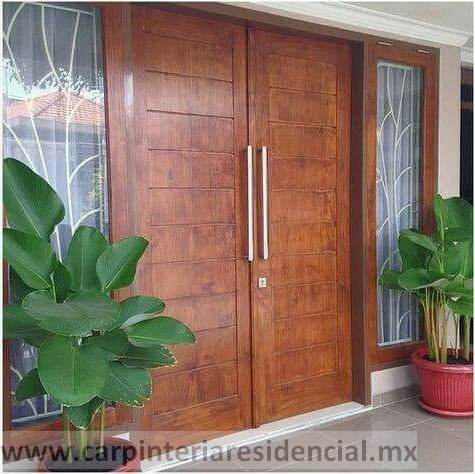 Puerta exterior de madera con vidrio carpinteria